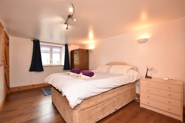 Bedroom 1: with double bed and en-suite with shower over bath, and toilet.