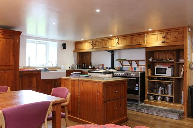 Kitchen area: with double electric range, microwave, fridge, freezer, dishwasher and washing machine.