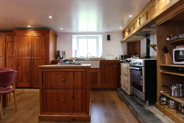 Kitchen area: with double electric range, microwave, fridge, freezer, dishwasher and washing machine.